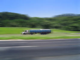 Thumb_truck-running-on-road-1449678